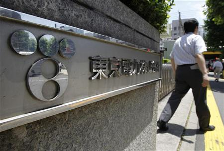 A man walks out from Tokyo Electric Power Co. (TEPCO) headquarters in Tokyo June 28, 2011. REUTERS/Toru Hanai