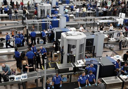Transportation Security Agency (TSA) workers carry out security checks at Denver International Airport, the day before the Thanksgiving holiday in Denver. REUTERS/Rick Wilking/Files
