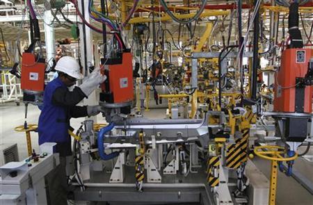 An employee assembles a part of a BharatBenz truck inside Daimler's new factory in Oragadam, in the Kancheepuram district of Tamil Nadu April 18, 2012. REUTERS/Babu/Files