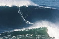 """Garrett McNamara of Haleiwa, Hawaii, won the Biggest Wave title at the 2012 Billabong XXL Big Wave Awards with this world record 78-foot wave ridden at Praia do Norte, Nazaré, Portugal on November 1, 2011 shown in this image released to Reuters on May 11, 2012. Big-wave surfer Garrett McNamara has been recognized by Guinness World Records for surfing the largest wave ever ridden, a towering 78-foot (24 -meter) wall of water he says he caught at Nazare, Portugal, in November while """"totally in the moment."""" McNamara's record-setting feat was verified by Guinness after an independent panel of big wave and photography experts painstakingly measured still and video images of the colossal wave, a spokeswoman for the agency said. REUTERS/Wilson Ribeiro/BillabongXXL.com/Handout"""