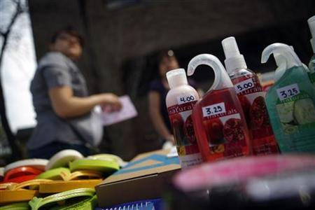 Avon ladies are seen selling products at a sale in New York April 18, 2009. REUTERS/Eric Thayer/Files