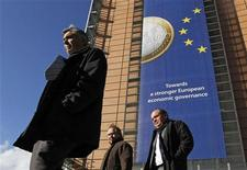 A banner featuring a Euro coin is seen on the European Commission headquarters building. REUTERS/Yves Herman