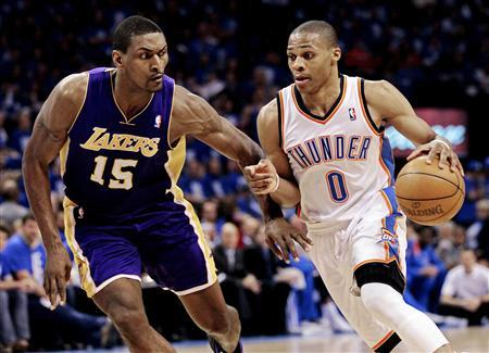 85fb8e50ea7 Los Angeles Lakers  Metta World Peace (15) guards Oklahoma City Thunder s  Russell Westbrook (0)during the second half of Game 1 of the NBA Western ...