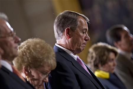 U.S. House Speaker John Boehner (R-OH) lowers his head during an event to commemorate Holocaust victims and survivors in the Capitol Rotunda in Washington April 19, 2012. REUTERS/Benjamin Myers