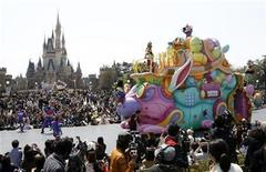 Disney character Mickey Mouse (top) performs atop a float during a parade at Tokyo Disneyland in Urayasu, east of Tokyo April 15, 2011. REUTERS/Issei Kato