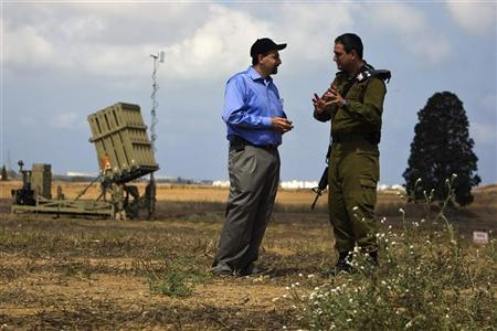 U.S ambassador to Israel Daniel Shapiro (L) listens to an Israeli army colonel as they stand next to a launcher, part of the Iron Dome rocket shield system in a field near the southern city of Ashkelon August 9, 2011. REUTERS/Amir Cohen