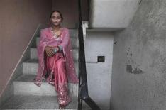 Seema, 33, poses for a picture outside a local non-governmental organisation (NGO) office, which supports sexual minorities, in New Delhi May 14, 2012. Seema is transgender, one of hundreds of thousands in conservative India who are ostracised, often abused and forced into prostitution due to no legal recognition, even as the world marks International Day against Homophobia and Transphobia on May 17. Picture taken May 14, 2012. REUTERS/Adnan Abidi