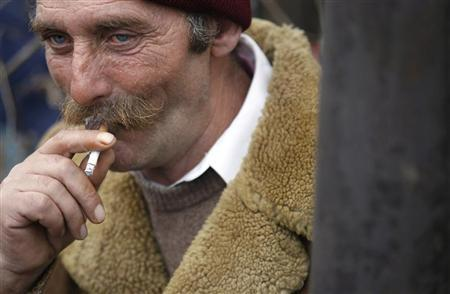 A Bulgarian farmer smokes a cigarette during a protest near the ferry link at the Danube border town of Oriahovo, some 180 km (111miles) north-east of the capital Sofia, February 4, 2009. REUTERS/Stoyan Nenov