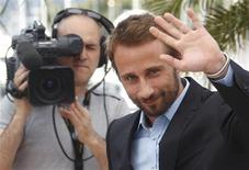 """Cast member Matthias Schoenaerts poses during a photocall for the film """"De rouille et d'os"""", by director Jacques Audiard, in competition at the 65th Cannes Film Festival, May 17, 2012. REUTERS/Christian Hartmann"""