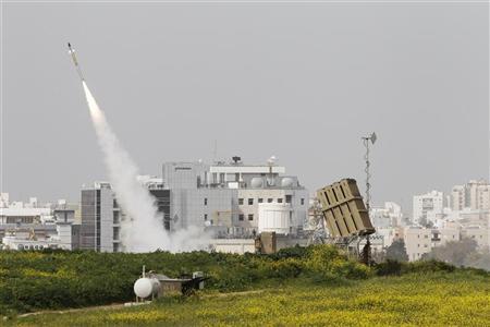 An Iron Dome launcher fires an interceptor rocket near the southern city of Ashdod March 12, 2012. REUTERS/Nir Elias