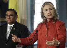 U.S. Secretary of State Hillary Clinton (R) speaks to reporters next to Myanmar's Foreign Minister Wunna Maung Lwin after their meeting at the State Department in Washington May 17, 2012. REUTERS/Yuri Gripas