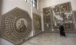 A visitor looks at mosaics at the Antakya Archaeology museum, also known as the Antakaya Mosaic museum, in Antakya, in the southern border province of Hatay, April 22, 2012. REUTERS/Murad Sezer