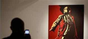 "A visitor looks at a painting of South Africa's President Jacob Zuma at an exhibition in Johannesburg May 18, 2012. South Africa's ruling ANC threatened to take legal action against a Johannesburg gallery for displaying art which lampoons Zuma and accuses the party of corruption. The works are part of a collection called ""Hail to the Thief"" and are meant to question whether the century-old African National Congress has lost its moral compass. REUTERS/Siphiwe Sibeko"