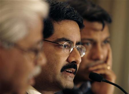 Kumar Mangalam Birla (C) speaks during a news conference in Mumbai February 11, 2007. REUTERS/Punit Paranjpe/Files