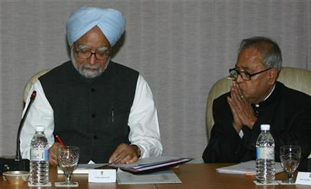 Prime Minister Manmohan Singh (L) and the then Foreign Minister Pranab Mukherjee attend an all-party meeting in New Delhi November 30, 2008. REUTERS/B Mathur/Files