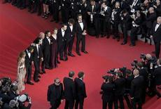 """Director John Hillcoat (4thL), screenwriter Nick Cave (3rdL) and cast members (LtoR) Jessica Chastain, Tom Hardy, Shia LaBeouf, Mia Wasikowska, Dane Dehaan, Jason Clarke and Guy Pearce arrive on the red carpet for the screening of the film """"Lawless"""", in competition at the 65th Cannes Film Festival, May 19, 2012. REUTERS/Virginia Mayo/Pool"""