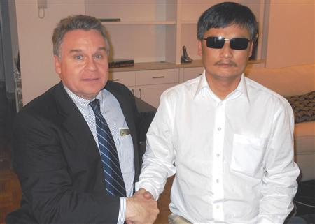 U.S. Rep. Chris Smith (R-NJ) meets with Chen Guangcheng (R) after arriving in New York May 19, 2012. REUTERS/Congressman Chris Smith's office/Handout