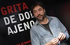 Spanish actor Javier Bardem poses for photographers after the presentation of a campaign by the Spanish NGO 'Medicos Sin Fronteras' (Medics Without Frontiers or MSF) in Madrid November 17, 2011. REUTERS/Andrea Comas