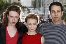 "REFILE - CORRECTING TITLE OF FILM TO ""ANTIVIRAL"" Director Brandon Cronenberg (R) poses with cast member Sarah Gadon (C) and Caleb Landry Jones during a photocall for the film ""Antiviral"" at the 65th Cannes Film Festival, May 20, 2012. REUTERS/Vincent Kessler"