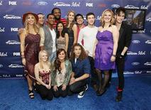 "Finalists (from L-R standing): Elise Testone, Jeremy Rosado, Joshua Ledet, Jermaine Jones, Jessica Sanchez, Shannon Magrane, Heejun Han, Phillip Phillips, Erika Van Pelt, Colton Dixon, (from L-R front): Hollie Cavanagh, Skylar Laine and Deandre Brackensick pose at the party for the finalists of the television show ""American Idol"" in Los Angeles, California March 1, 2012. REUTERS/Mario Anzuoni"