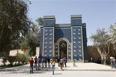 Visitors gather in front of a replica of the Ishtar Gate of Ancient Babylon near Hilla, 100 km (62 miles) south of Baghdad April 5, 2012. REUTERS/Saad Shalash
