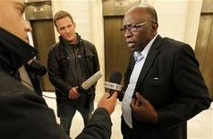 Former FIFA executive member Jack Warner (R) talks to journalists in Zurich, May 30, 2011. REUTERS/Arnd Wiegmann