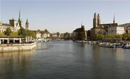 A general view shows the city of Zurich and the Limmat River during sunny spring weather May 14, 2012. At background left are the church towers of the Fraumuenster and St. Peter and on the right the Grossmuenster church. REUTERS/Arnd Wiegmann
