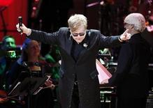 """Musician Elton John performs during the benefit """"Songs From the Silver Screen"""" to raise funds for The Rainforest Trust at Carnegie Hall in New York April 3, 2012. REUTERS/Carlo Allegri"""