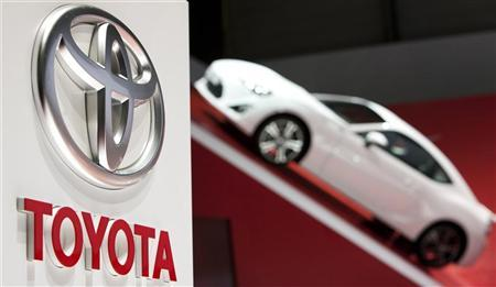 A logo is seen on Toyota's booth during the first media day of the Geneva Auto Show at the Palexpo in Geneva, March 6, 2012. REUTERS/Valentin Flauraud/Files
