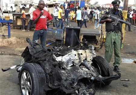 Part of a car used for detonating a bomb is seen at the scene of a blast in Nigeria's northern city of Kaduna April 8, 2012. Suspected members of Nigerian Islamist sect Boko Haram have killed four people and a large undetonated bomb was found in Kano on Monday, authorities said, a day after at least 36 people were killed in a car bomb near a church in northern Kaduna. Picture taken April 8, 2012. REUTERS/Stringer