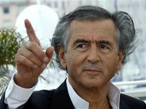 """Director Bernard-Henry Levy poses during a photocall for the film """"Le Serment de Tobrouk"""" at the 65th Cannes Film Festival, May 25, 2012. REUTERS/Jean-Paul Pelissier"""