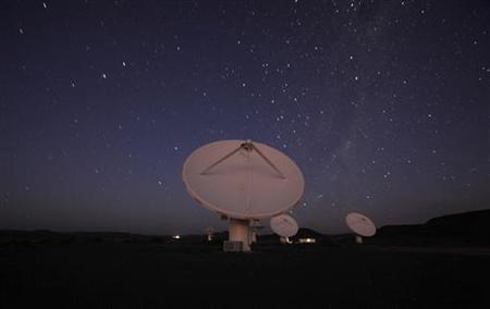 Night falls over radio telescope dishes of the KAT-7 Array at the proposed South African site for the Square Kilometre Array (SKA) telescope near Carnavon in the country's remote Northern Cape province in this long exposure picture taken May 17, 2012. REUTERS/Mike Hutchings