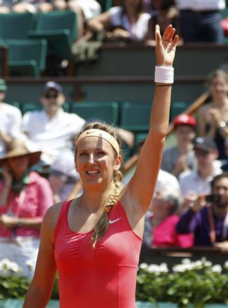 Victoria Azarenka of Belarus waves after winning her match against Alberta Brianti of Italy during the French Open tennis tournament at the Roland Garros stadium in Paris May 28, 2012. REUTERS/Regis Duvignau