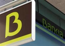 The logo of Spain's Bankia bank is seen on a wall of one of its branches in Madrid May 28, 2012. Spanish debt yields jumped and shares in fourth-largest lender Bankia SA plunged to record lows, highlighting a lack of confidence in government efforts to stabilise the finances of Spain and its ailing banks. REUTERS/Sergio Perez