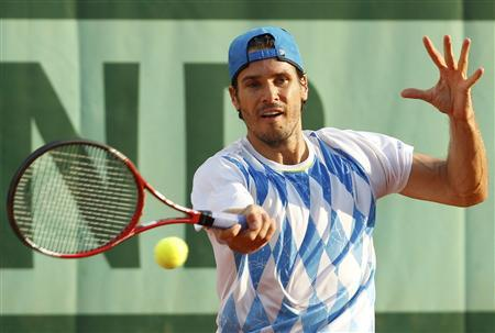 Tommy Haas of Germany returns the ball to Filippo Volandri of Italy during the French Open tennis tournament at the Roland Garros stadium in Paris May 28, 2012. REUTERS/Regis Duvignau