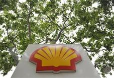 A logo is seen under a canopy of trees at a Shell petrol station in central London July 29, 2010. REUTERS/Toby Melville