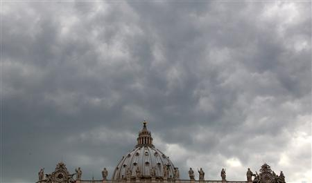 Clouds are seen over Saint Peter cathedral at the Vatican in this April 16, 2011 file photo. REUTERS/Stefano Rellandini/Files