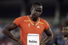Campeão olímpico de corrida com obstáculos, o cubano Dayron Robles, reage após terminar em terceiro na final masculina de 100m com barreiras, durante o Grande Prêmio de Ponce. 12/05/2012 REUTERS/Ricardo Arduengo