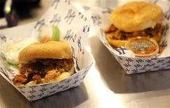 A pulled pork and a pulled chicken sandwich are displayed during a media food tour at Yankee Stadium in New York April 15, 2009. REUTERS/Eric Thayer
