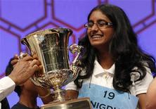 Snigdha Nandipati, 14, of San Diego, California, holds her trophy after winning the Scripps National Spelling Bee at National Harbor in Maryland May 31, 2012. REUTERS/Kevin Lamarque