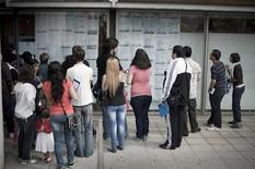 People look at job offers at the Clara Campoamor centre in Barakaldo during an annual open day in which local council organization Inguralde arrange interviews between job seekers and businesses, May 17, 2012. REUTERS/Vincent West