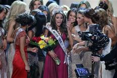Miss Rhode Island Olivia Culpo (C) is congratulated by fellow contestants after being crowned Miss America 2012 during the Miss USA pageant at the Planet Hollywood Resort & Casino in Las Vegas, Nevada June 3, 2012. REUTERS/Steve Marcus