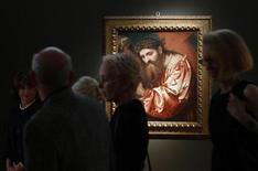 People walk past the painting 'Christ Carrying the Cross' during a preview of an upcoming auction at Christie's in New York, June 1, 2012. REUTERS/Eric Thayer