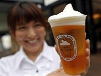 An employee poses with a cup of Kirin's frozen beer at a beer garden in Tokyo June 5, 2012. REUTERS/Toru Hanai