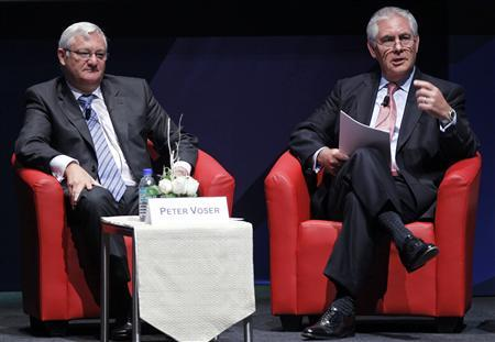 Chairman and Chief Executive Officer of Exxon Mobil Corporation Rex Tillerson (R) speaks as Chief Executive Officer of Royal Dutch Shell Peter Voser listens during the World Gas Conference 2012 in Kuala Lumpur June 5, 2012. REUTERS/Bazuki Muhammad