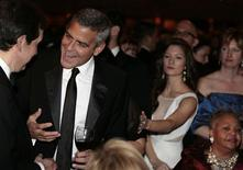 Actor George Clooney (2nd L) talks before the White House Correspondents' Association annual dinner in Washington April 28, 2012. REUTERS/Larry Downing