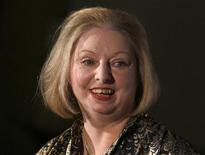 "Author Hilary Mantel laughs during a photocall after winning the 2009 Man Booker Prize for Fiction with her book ""Wolf Hall"" the the Guildhall in London October 6, 2009. REUTERS/Luke MacGregor"