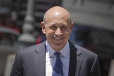 Goldman Sachs Chairman and Chief Executive Lloyd Blankfein smiles as he walks towards the Manhattan federal court in New York June 7, 2012. REUTERS/Andrew Kelly