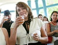 Natasha Tretheway, author of three poetry collections and winner of the Pulitzer Prize, raises a toast after she was named the 19th U.S. poet laureate,during a celebration in Decatur, Georgia June 7, 2012. Tretheway is only the second Southerner appointed to the position and will officially take up her duties in the fall. REUTERS/Tami Chappell