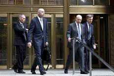 Goldman Sachs Chairman and Chief Executive Lloyd Blankfein (2nd R) leaves the Manhattan federal court after attending the Rajat Gupta insider-trading trial in New York June 7, 2012. Blankfein told a federal court jury on Thursday that he did not authorize former board member Gupta to share information about the bank that was discussed at board meetings. REUTERS/Kena Betancur